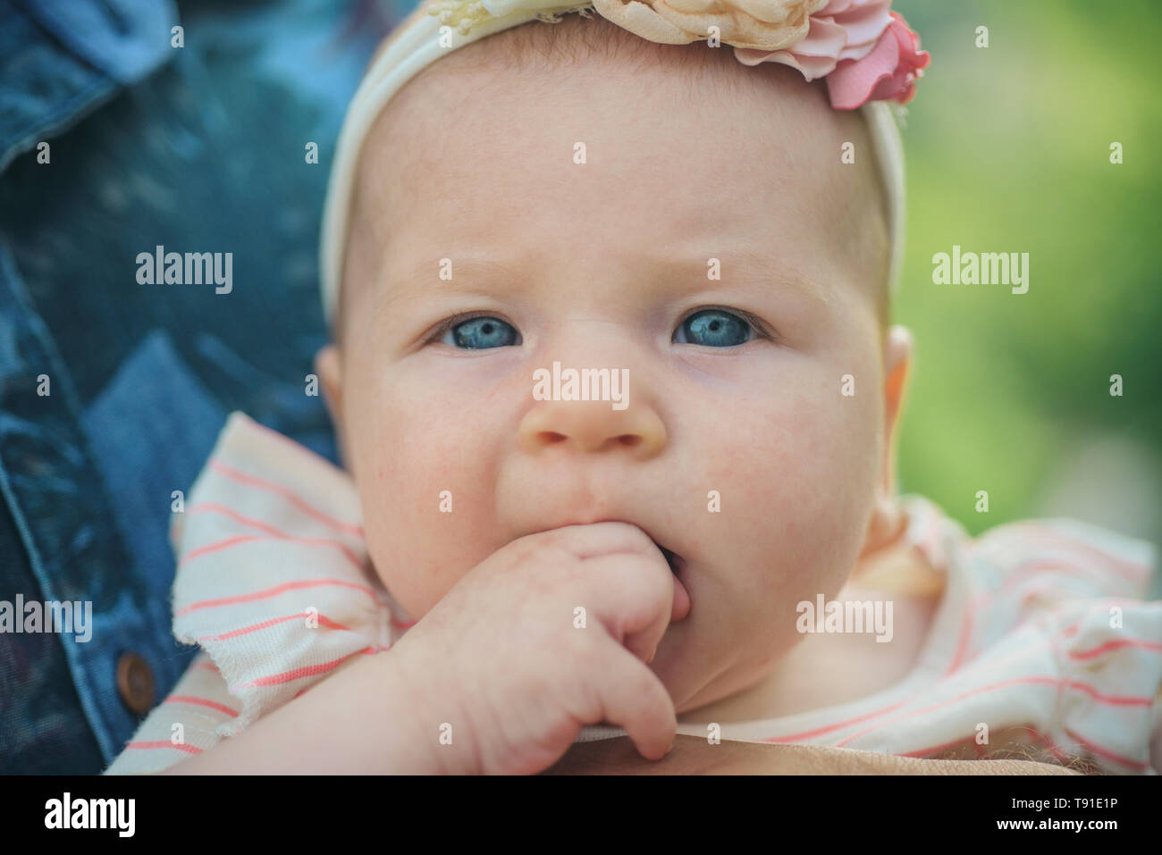 Newborn immunity is only temporary. Little newborn. Baby girl. Little cutie. Developing babys immunity and immune system. Make sure your child is up - Stock Image