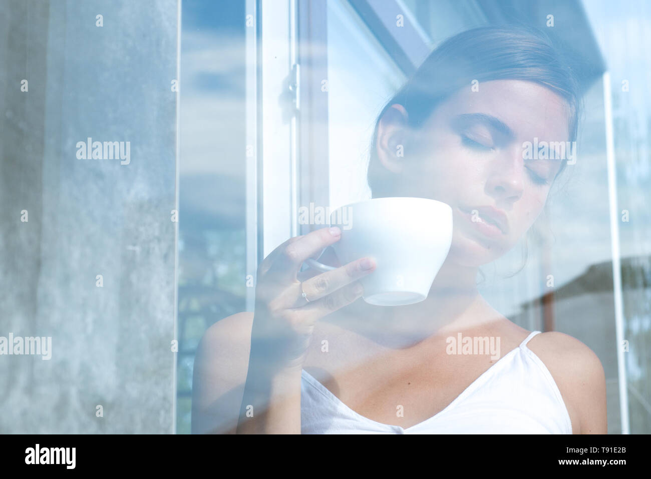 americano or espresso latte of girl. girl relax in cafe and drink. perfect morning with best coffee. woman drink coffee from cup. Morning coffee - Stock Image