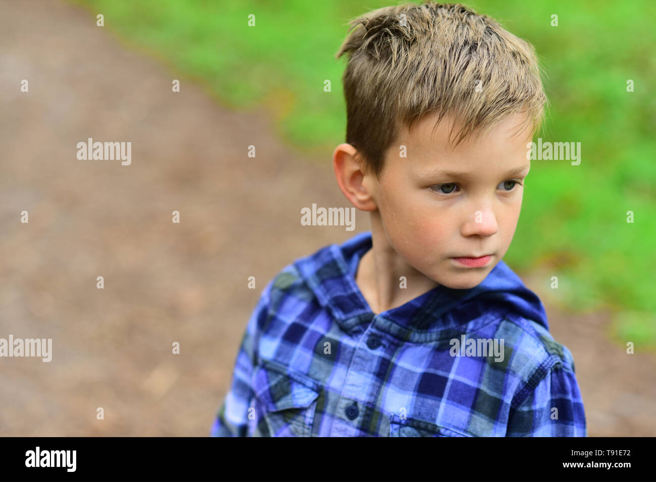I keep my hair natural. Little boy with short hair. Little boy with stylish haircut. To get their hair done makes a person feels better - Stock Image