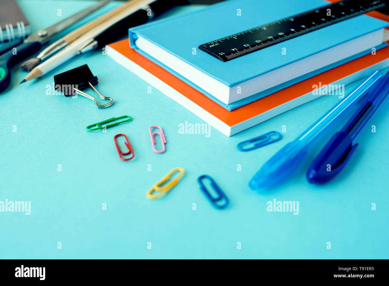 School supplies on blue background. Close up. Stock Photo