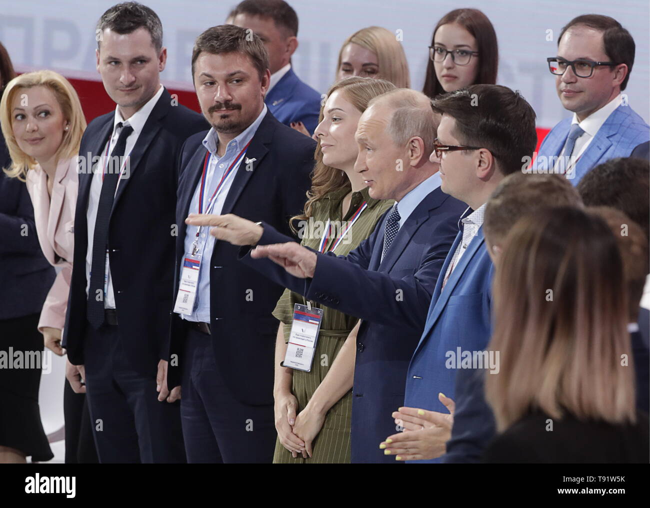 Sochi, Russia. 16th May, 2019. SOCHI, RUSSIA - MAY 16, 2019: Russia's President Vladimir Putin (C) arrives at the plenary meeting at the Independent Local and Regional Media Forum held by the All-Russian People's Front. Picutred in this image is also Deputy State Duma Chairperson Olga Timofeyeva (L). Mikhail Metzel/TASS Credit: ITAR-TASS News Agency/Alamy Live News - Stock Image