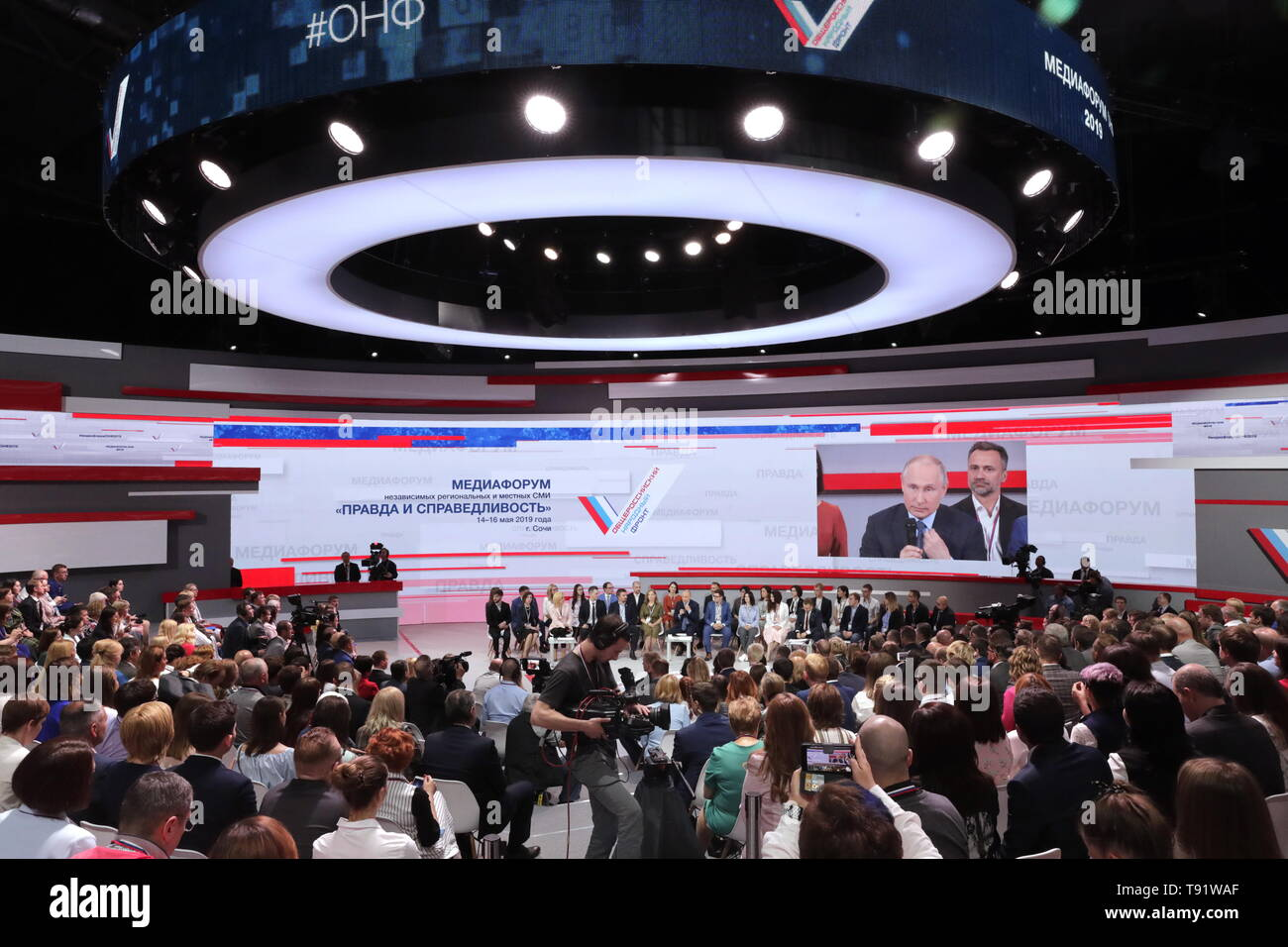 Sochi, Russia. 16th May, 2019. SOCHI, RUSSIA - MAY 16, 2019: A screem shows Russia's President Vladimir Putin speaking at the plenary meeting at the Independent Local and Regional Media Forum held by the All-Russian People's Front. Mikhail Metzel/TASS Credit: ITAR-TASS News Agency/Alamy Live News - Stock Image