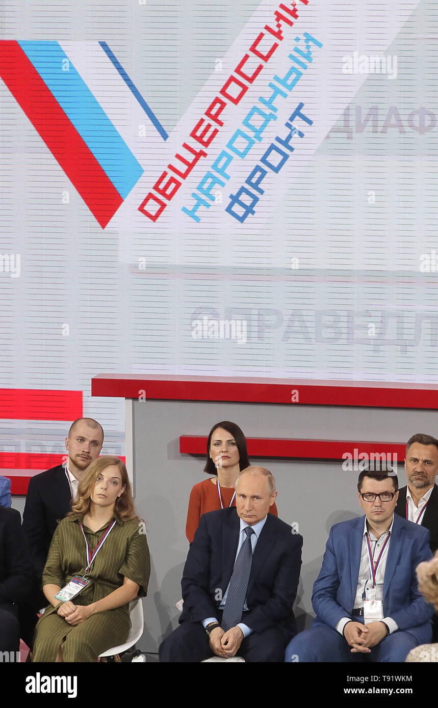 Sochi, Russia. 16th May, 2019. SOCHI, RUSSIA - MAY 16, 2019: Russia's President Vladimir Putin (C front) attends the plenary meeting at the Independent Local and Regional Media Forum held by the All-Russian People's Front. Mikhail Metzel/TASS Credit: ITAR-TASS News Agency/Alamy Live News - Stock Image