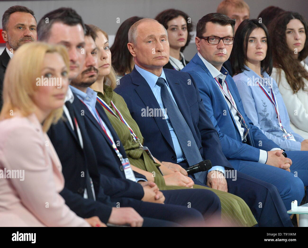 Sochi, Russia. 16th May, 2019. SOCHI, RUSSIA - MAY 16, 2019: Russia's President Vladimir Putin (C) attends the plenary meeting at the 6th Independent Local and Regional Media Forum held by the All-Russian People's Front. Pictured in this image is also Deputy State Duma Chairperson Olga Timfeyeva (L). Alexei Druzhinin/Russian Presidential Press and Information Office/TASS Credit: ITAR-TASS News Agency/Alamy Live News - Stock Image