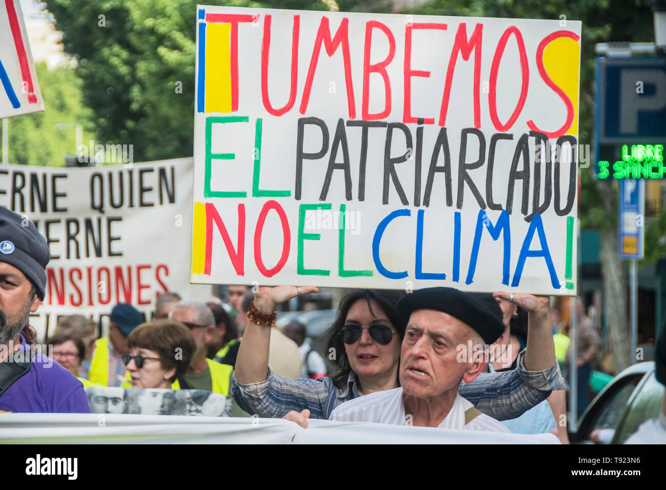 In the picture a woman with a placard, you know that is the  patriarchy not the climate 8 years celebration of the political project in Madrid 15 m, t - Stock Image