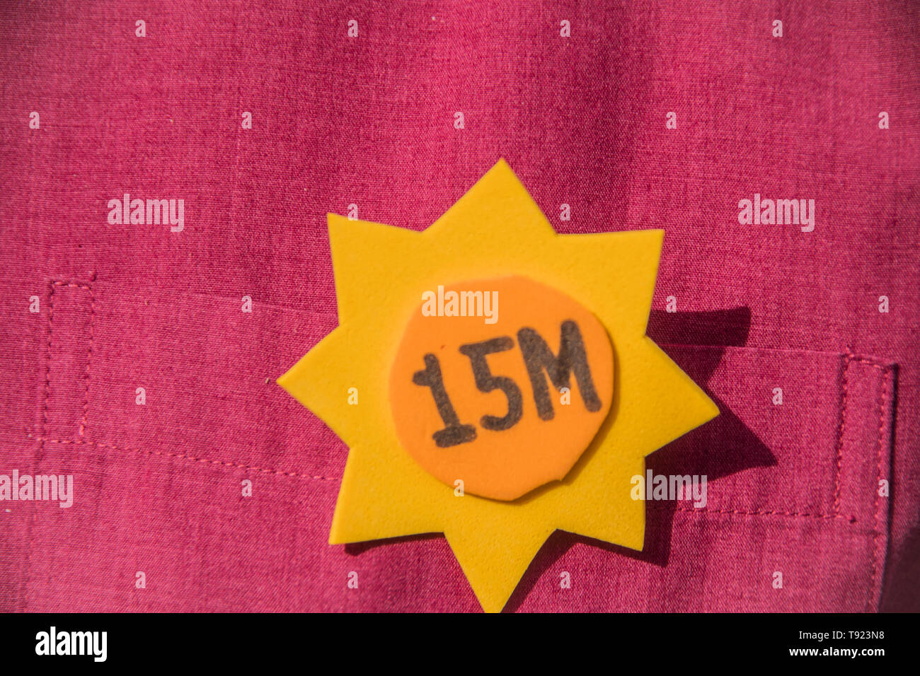 In the picture a badge of 15m in a t shirt. 8 years celebration of the political project in Madrid 15 m, the people of Madrid took from the streets a  - Stock Image