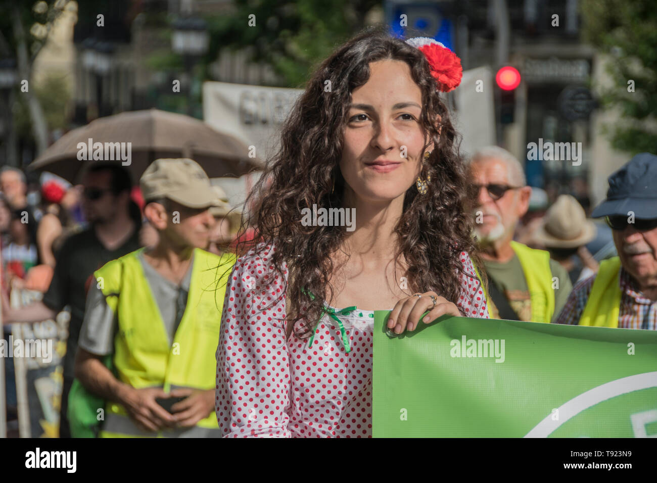 In the picture a girl with typical dress of San Iisdro Holliday in Madrid. 8 years celebration of the political project in Madrid 15 m, the people of  - Stock Image