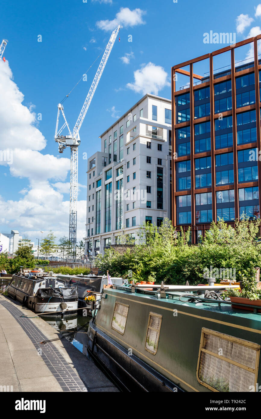 Narrowboats moored on Regent's Canal as the area's redevelopment continues, King's Cross, London, UK, 2019 - Stock Image