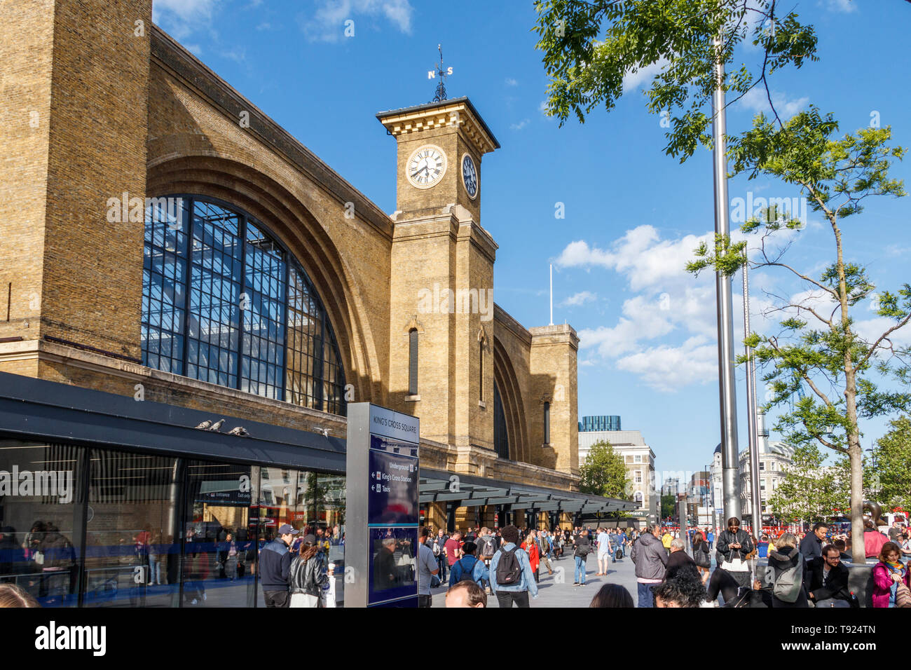The façade and forecourt of King's Cross Station and clock tower, London, UK, 2019 - Stock Image