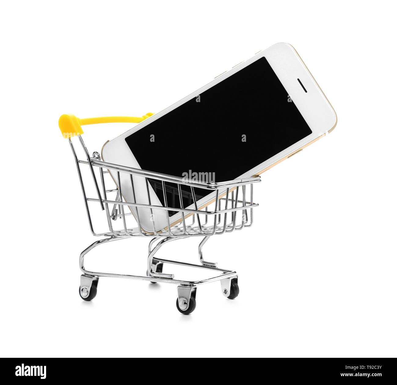 d19a262870d Small cart with mobile phone on white background. Shopping concept - Stock  Image