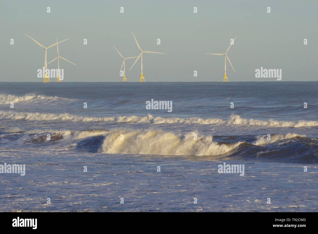 European Offshore Wind Deployment Centre with Rough Waves Breaking onto Aberdeen Beach During a Winter Storm. Scotland, UK. - Stock Image