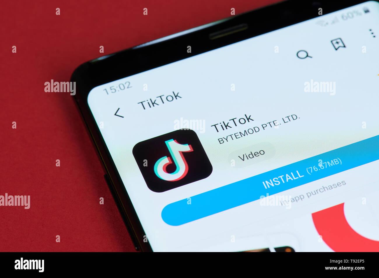 New york, USA - May 15, 2019: Installing TikTok app on
