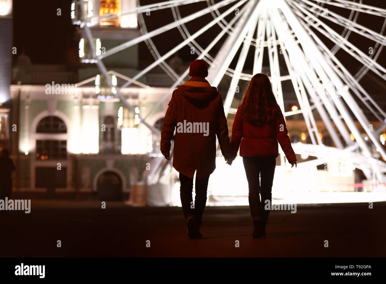 Loving Young Couple On Romantic Date Near Ferris Wheel In Evening Stock Photo Alamy