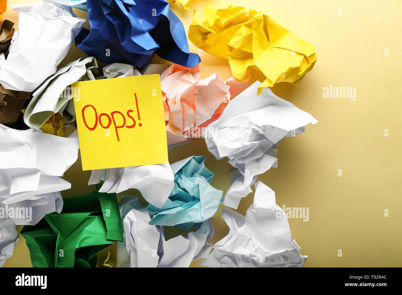 Sticker with text OOPS on crumpled papers. Mistake concept - Stock Image