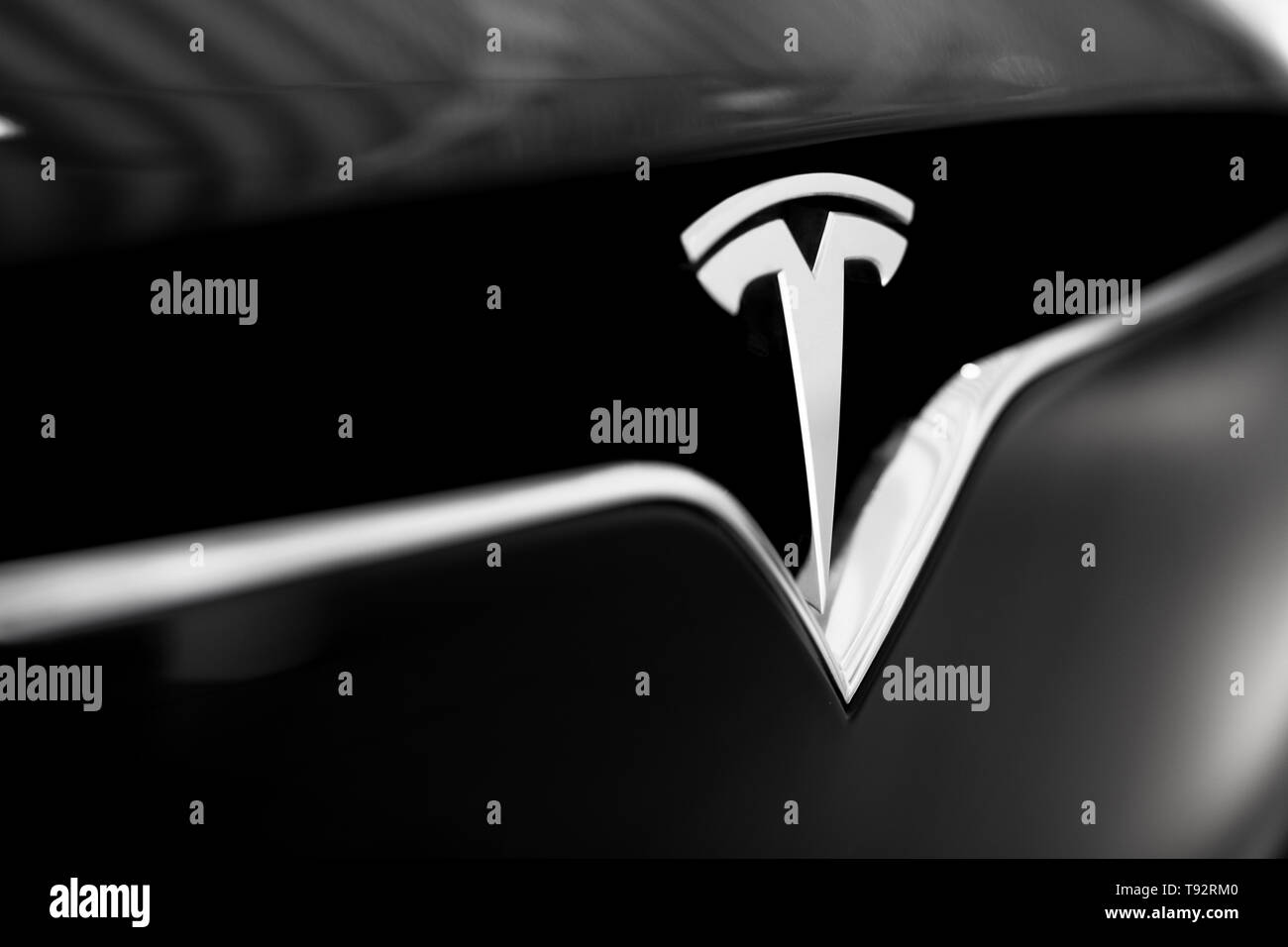 Tesla Emblem On Black Car Close Up Silver Logo Stock Photo Alamy