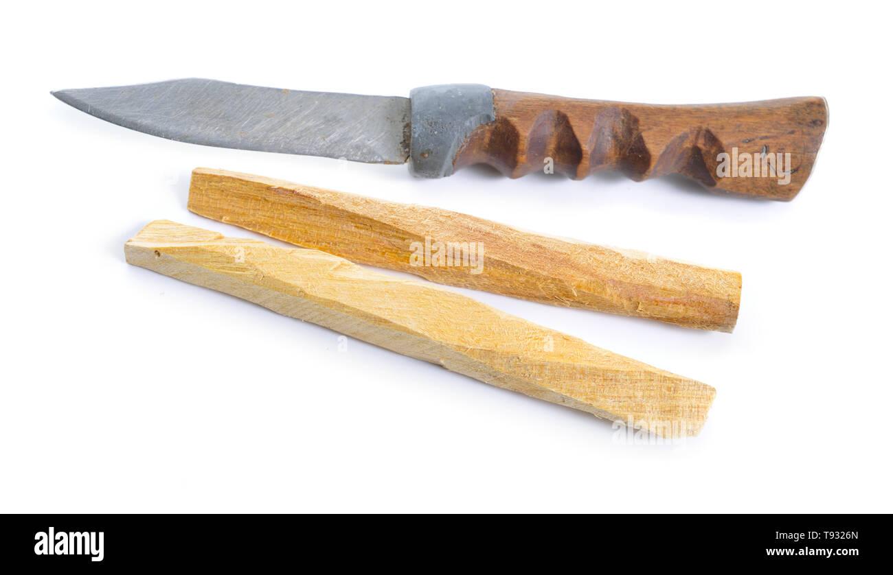 Palo santo, Holy Wood sticks with handmade knife isolated on white background. - Stock Image