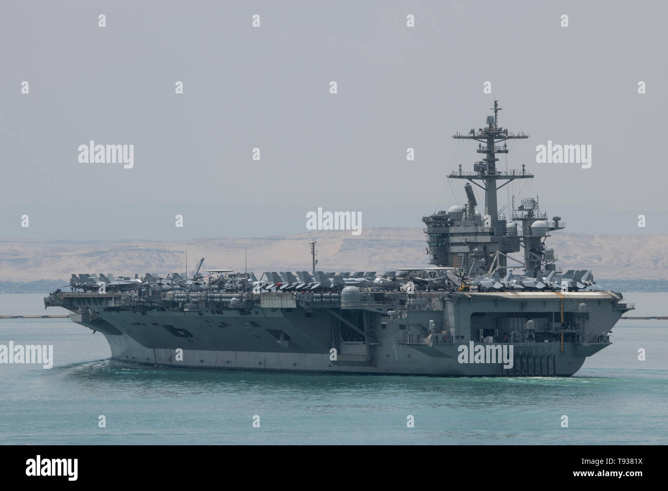 Egypt, Suez Canal. Abraham Lincoln Strike Group (ABECSG) transiting Suez Canal, May 9, 2019. Nimitz-class aircraft carrier USS Abraham Lincoln (CVN 72 - Stock Image