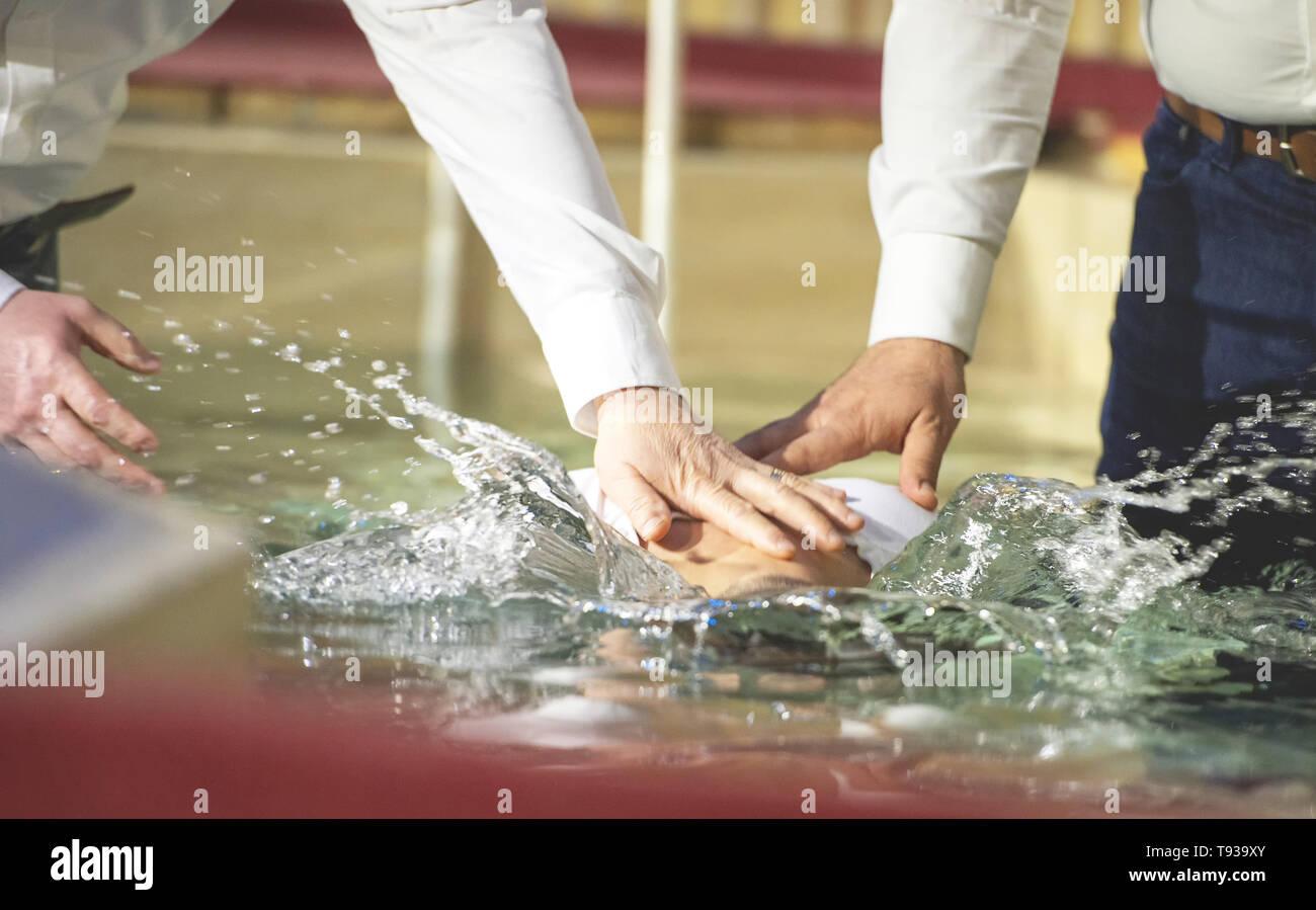 Close up of pastors hands who baptize man - Stock Image
