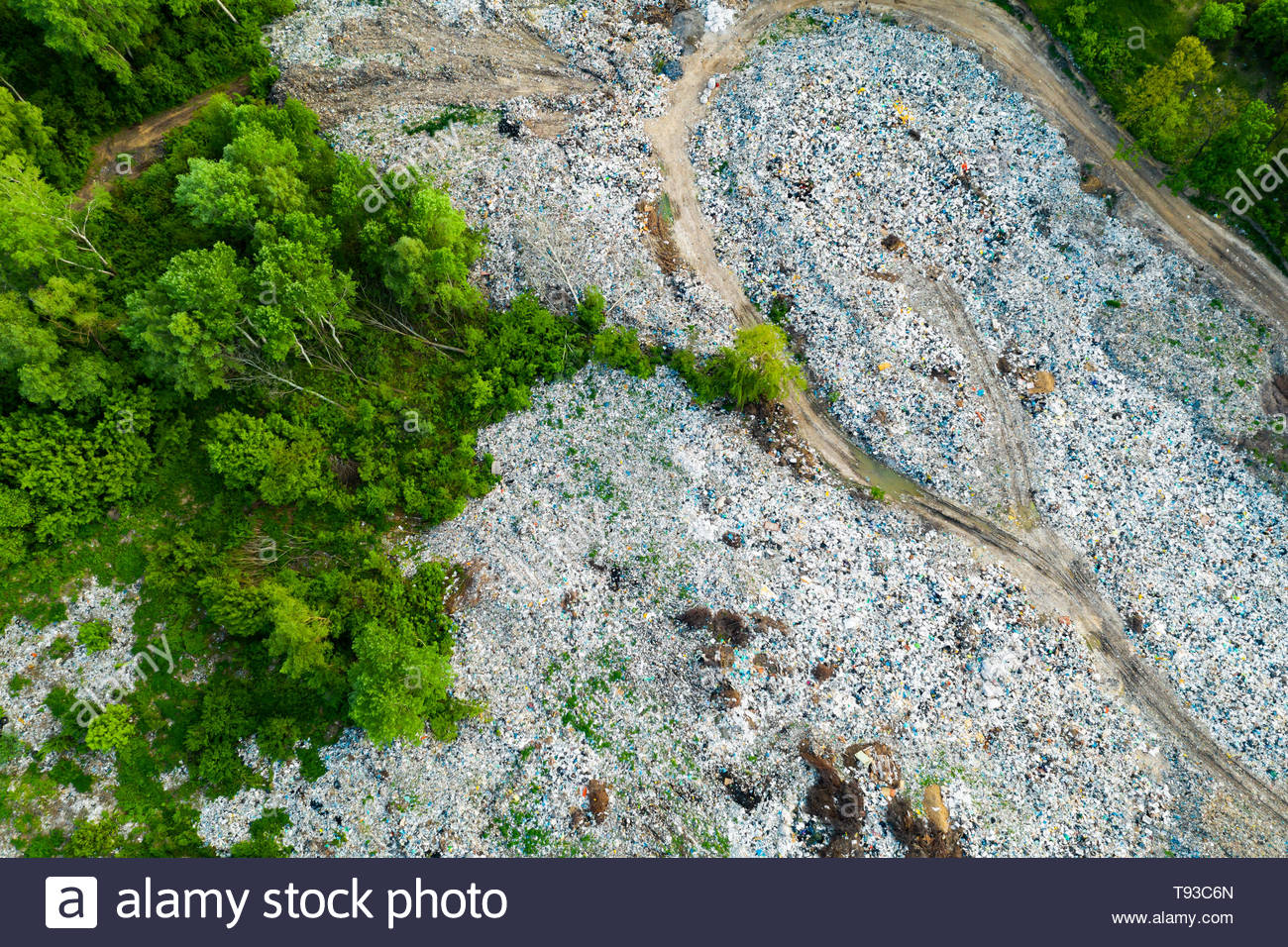 Aerial view of dump in forest. Pollution concept, top view. - Stock Image