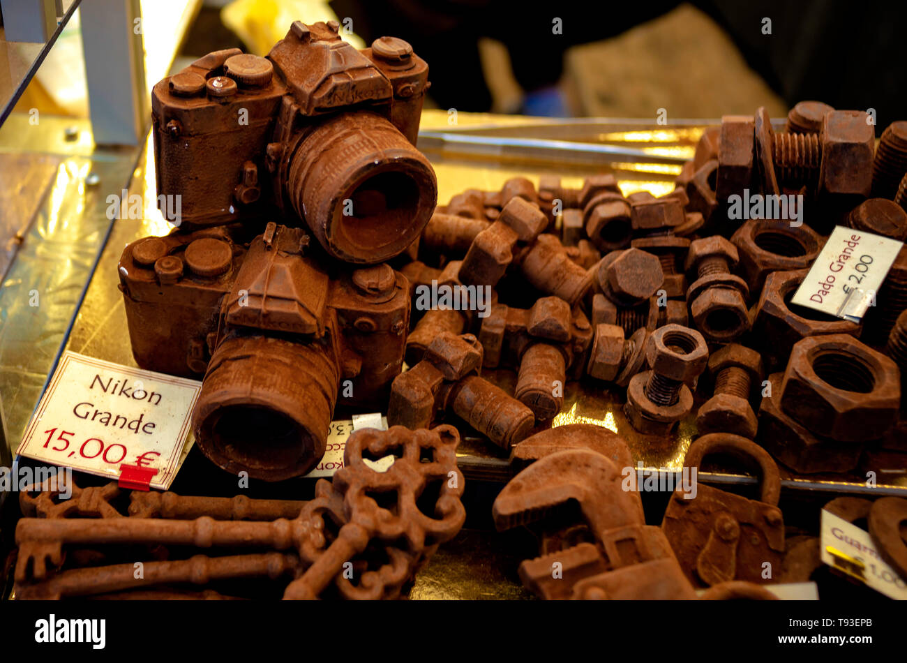 Sculptures made with chocolate during a fair. Featured miniature SLR machine, nuts, bolts, etc. - Stock Image