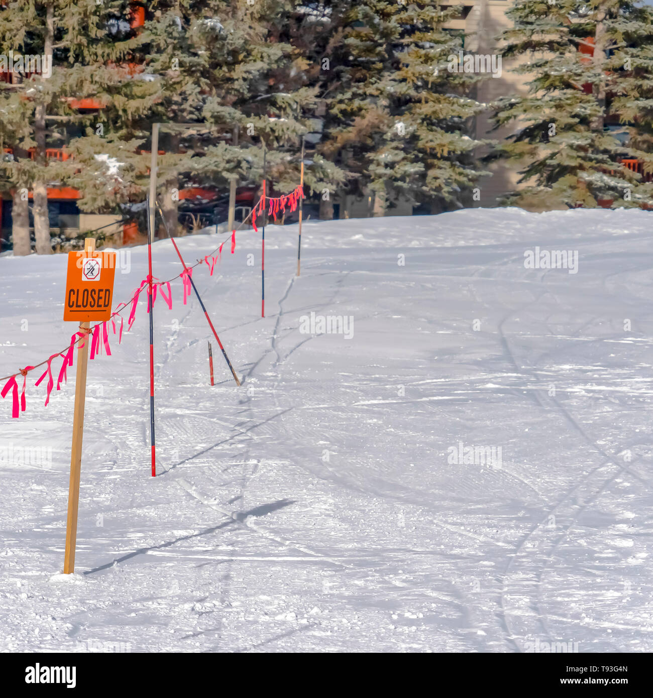 Closed sign and barricade against a ground covered with dense snow in Park City - Stock Image