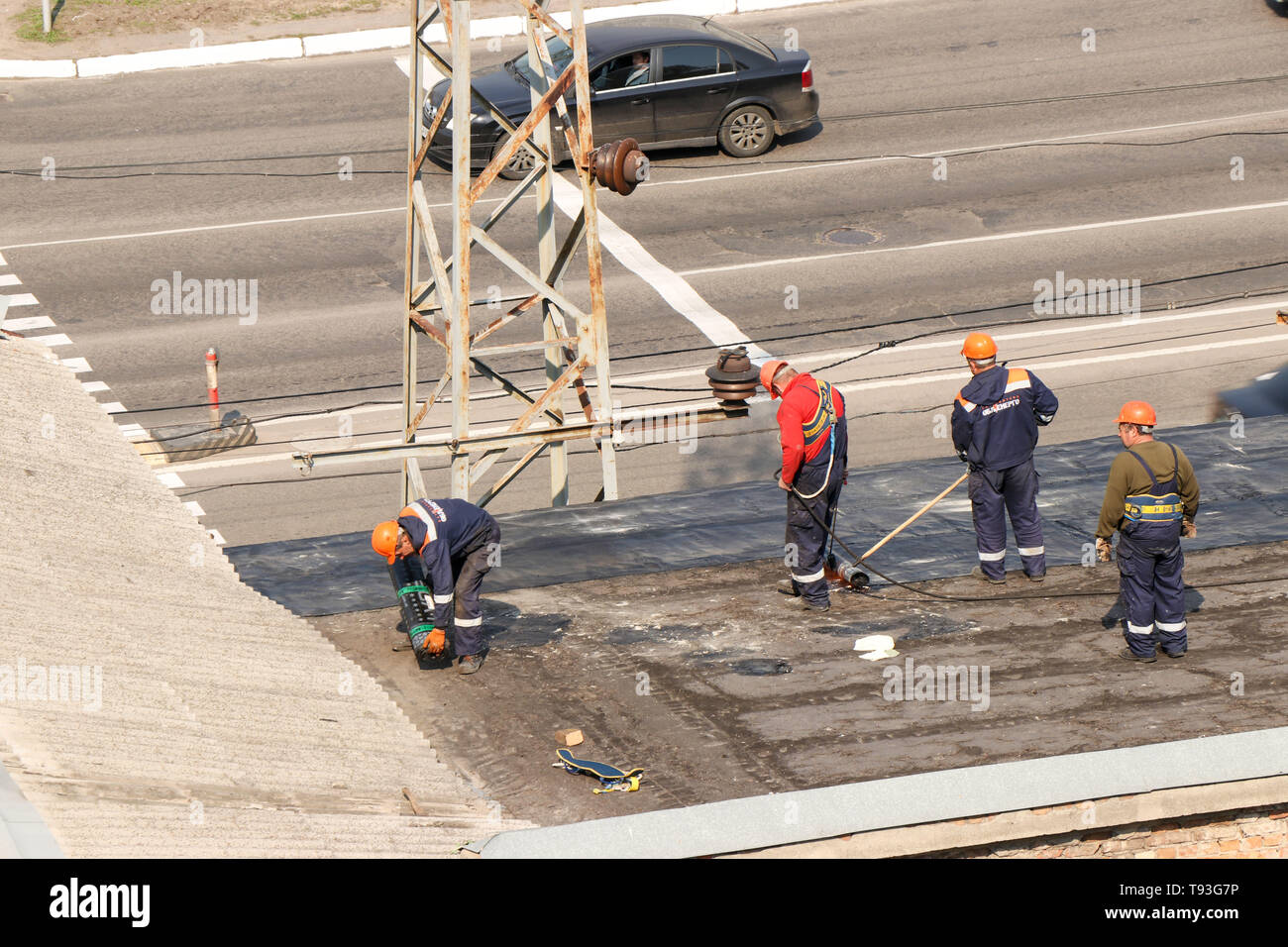 Kremenchug, Poltava region, Ukraine, April 23, 2019, repair of the old roof of the building, the roof is covered with new ruberoid - Stock Image