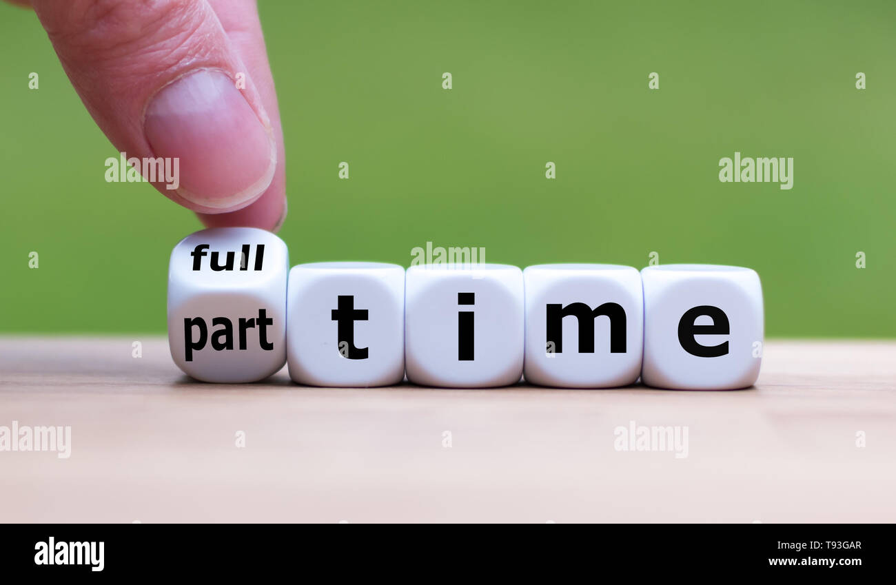 Hand is turning a dice and changes the word 'full-time' to 'part-time' (or vice versa). - Stock Image