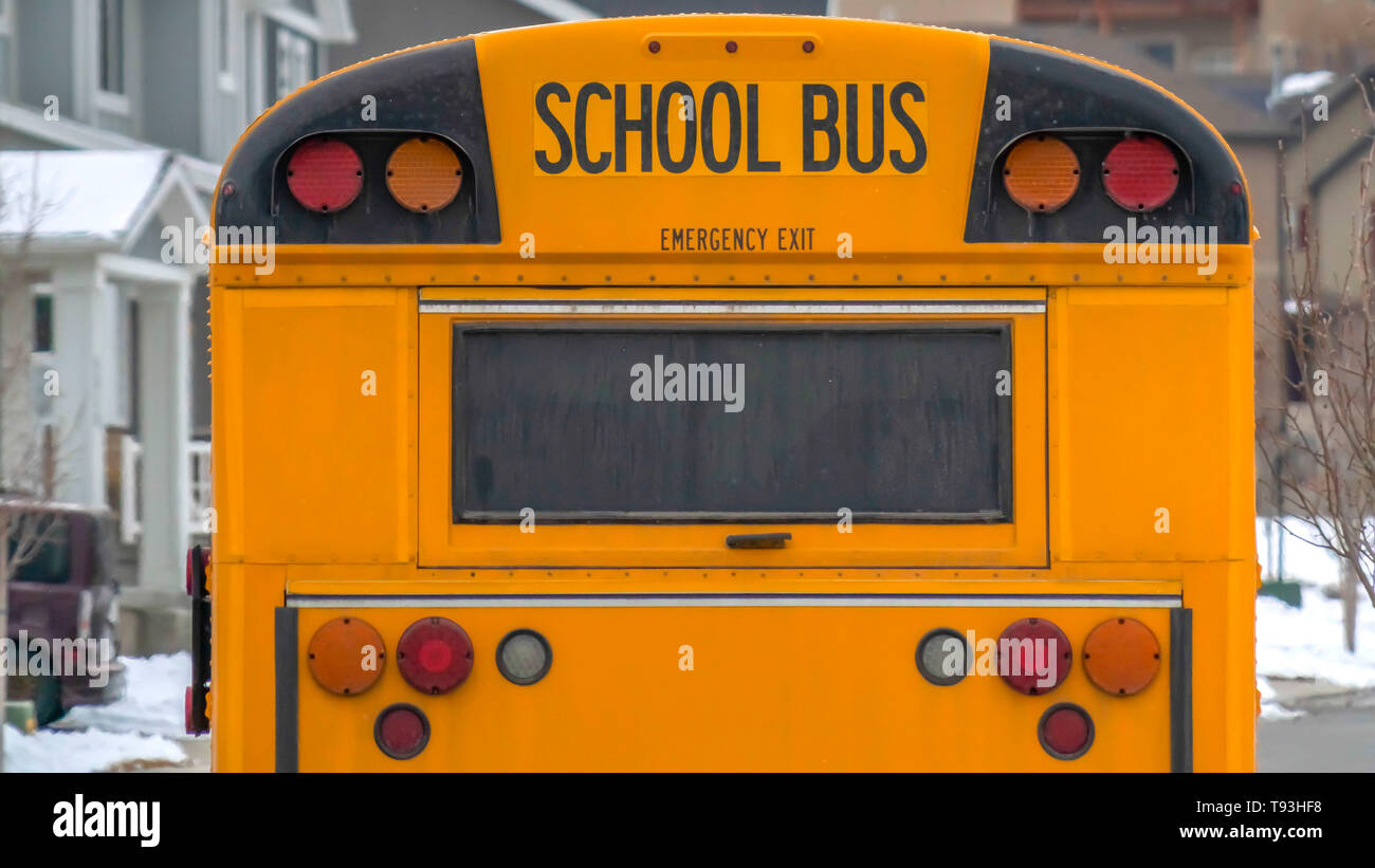 Clear Panorama Yellow school bus with rectangular window and several signal lights at the rear - Stock Image