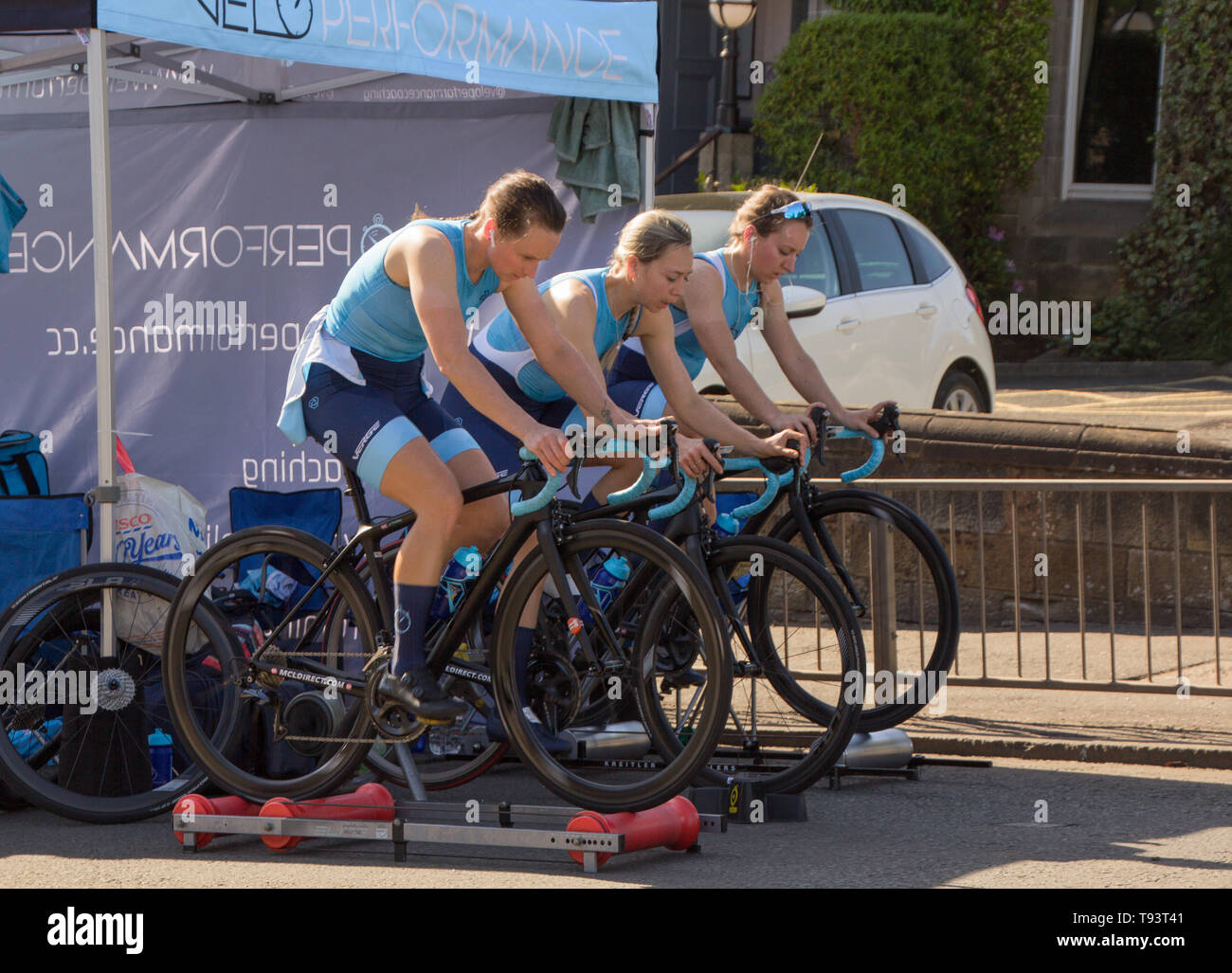 Women Velo Performance Team heating up before race on OVO Energy Tour Series - Motherwell, Scotland 2019 Stock Photo