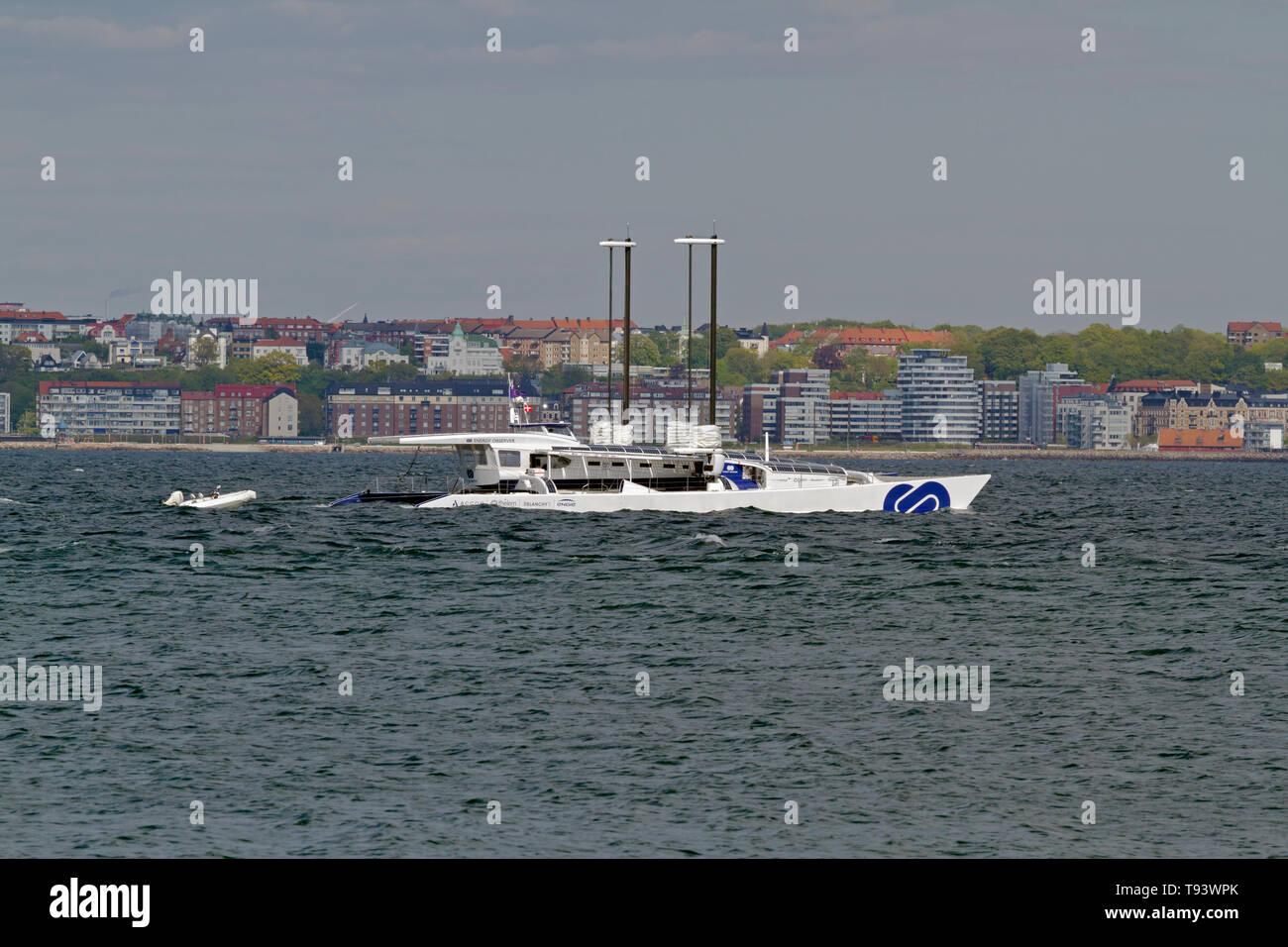 The wind, solar and hydrogen powered ENERGY OBSERVER in the Sound, Øresund, north of Elsinore on its odyssey around the world headed for Copenhagen. - Stock Image