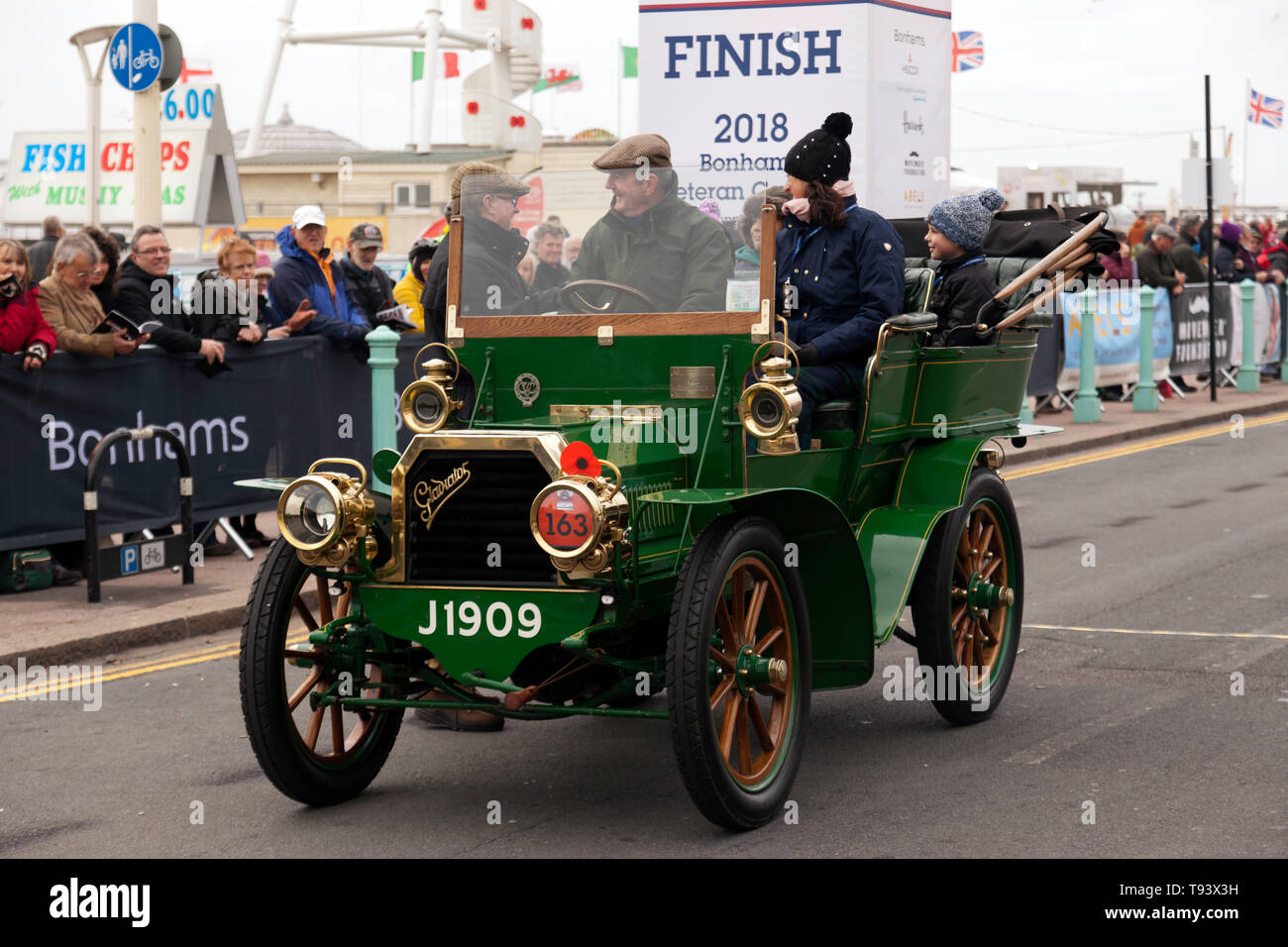 Mr Geoffrey Grime being interviewed, after driving his 1902 Gladiator, across the finishing line of the 2018 London to Brighton Veteran Car Run - Stock Image