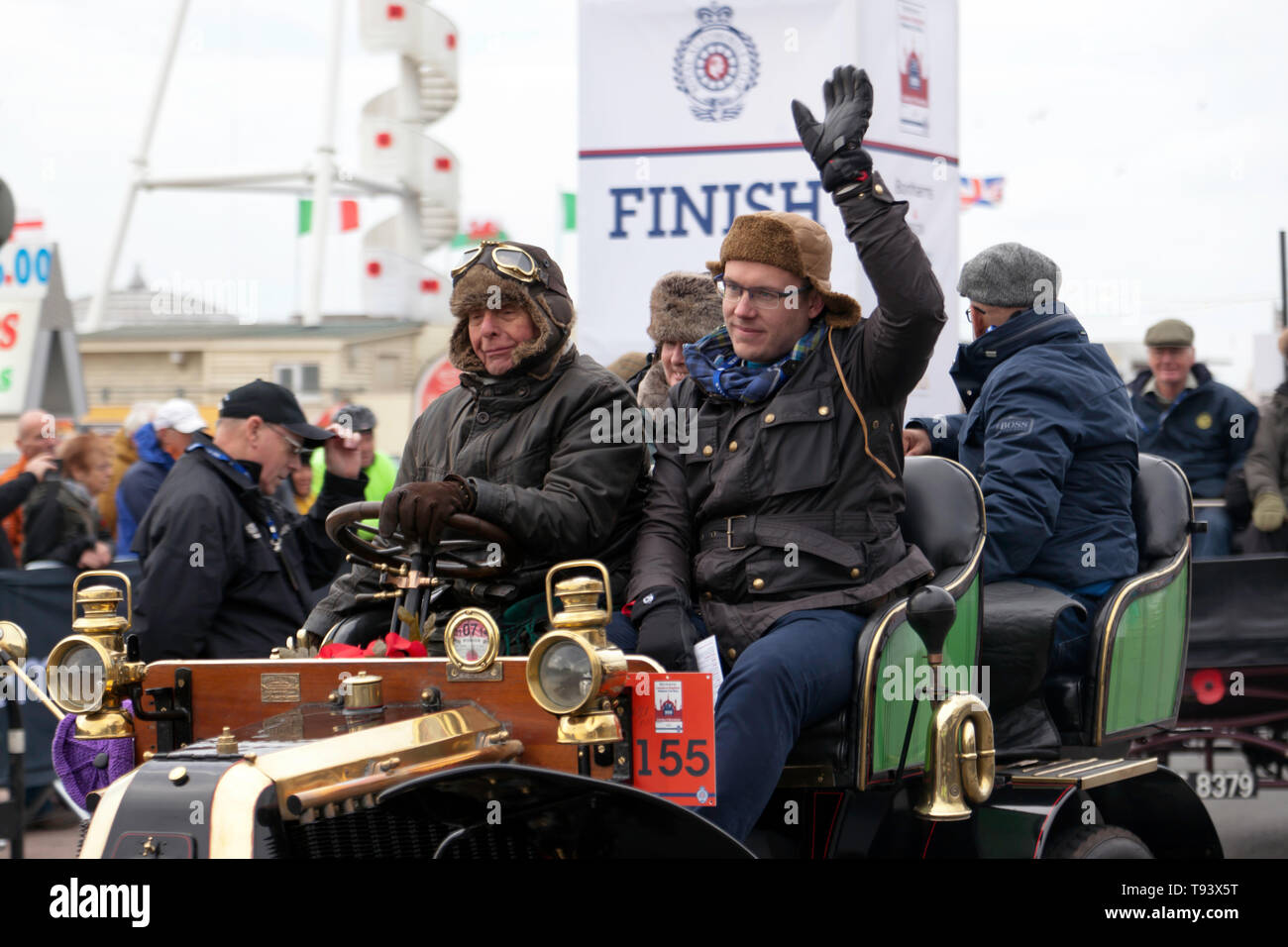 Mr Cliff Jowsey driving his 1902 Renault, across the finishing line in the 2018 London to Brighton Veteran Car Run Stock Photo