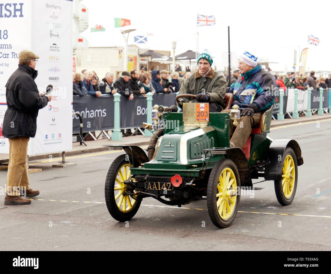 Mr Will Clarke driving a 1903 Napoleon,  across the finishing line of the 2018 London to Brighton Veteran Car Run. Stock Photo