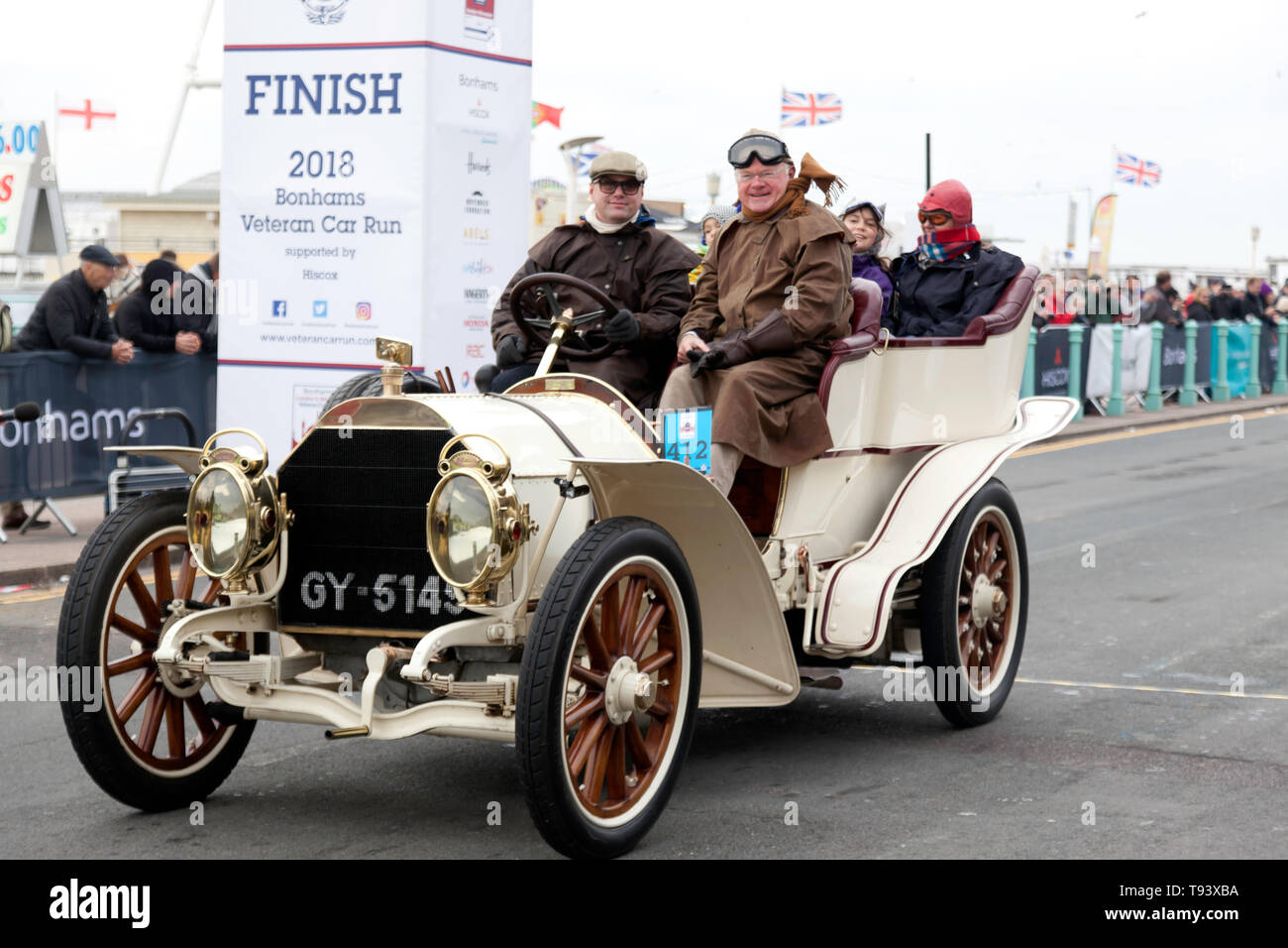 A 1903, White Mercedes crosses the finishing line during the 2018 London to Brighton Veteran Car Run Stock Photo