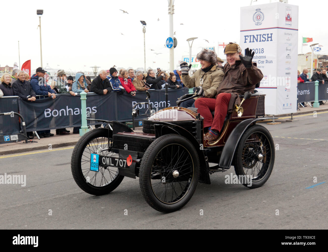 A 1899 Wolseley, entered by the British Motor Museum, crosses the finishing line, during the 2018 London to Brighton Veteran Car Run Stock Photo