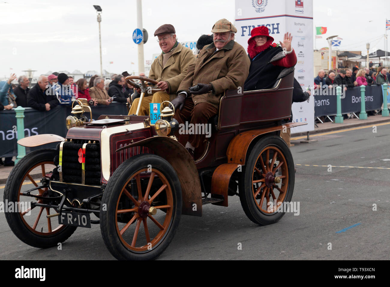 Mr Tim Dickson at the wheel of his 1902, Panhard Et Levassor, crossing the finishing line at the end of the 2018 London to Brighton Veteran car run Stock Photo