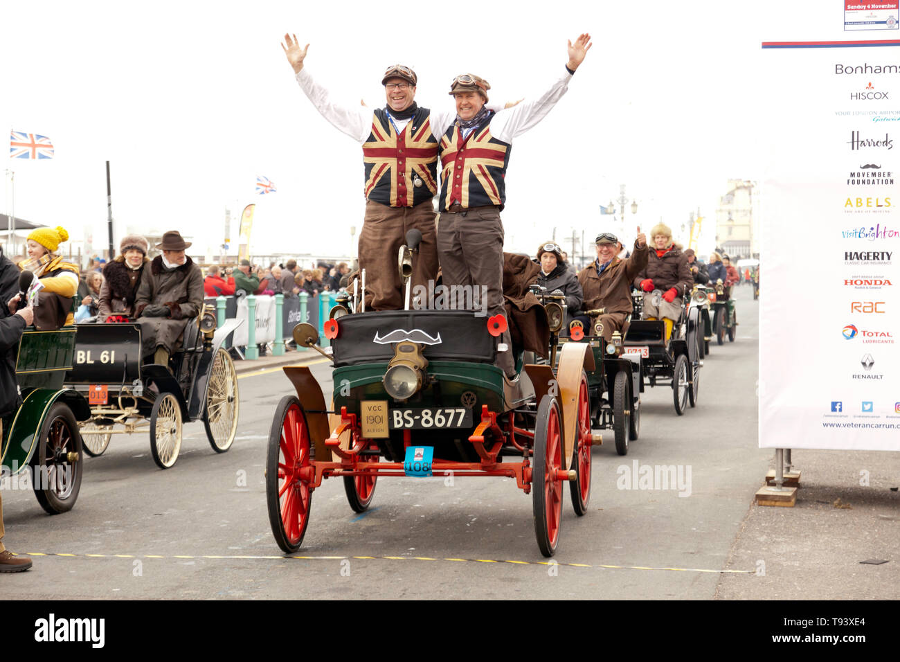 Mr Mark Farrall and Friend celebrating in their 1901 Albion, at the finish line of the 2018 London to Brighton Veteran Car Run. Stock Photo