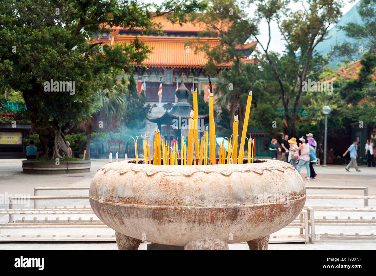 Traditional smoking candles in front of the Chinese monastery in Hong Kong - Stock Image