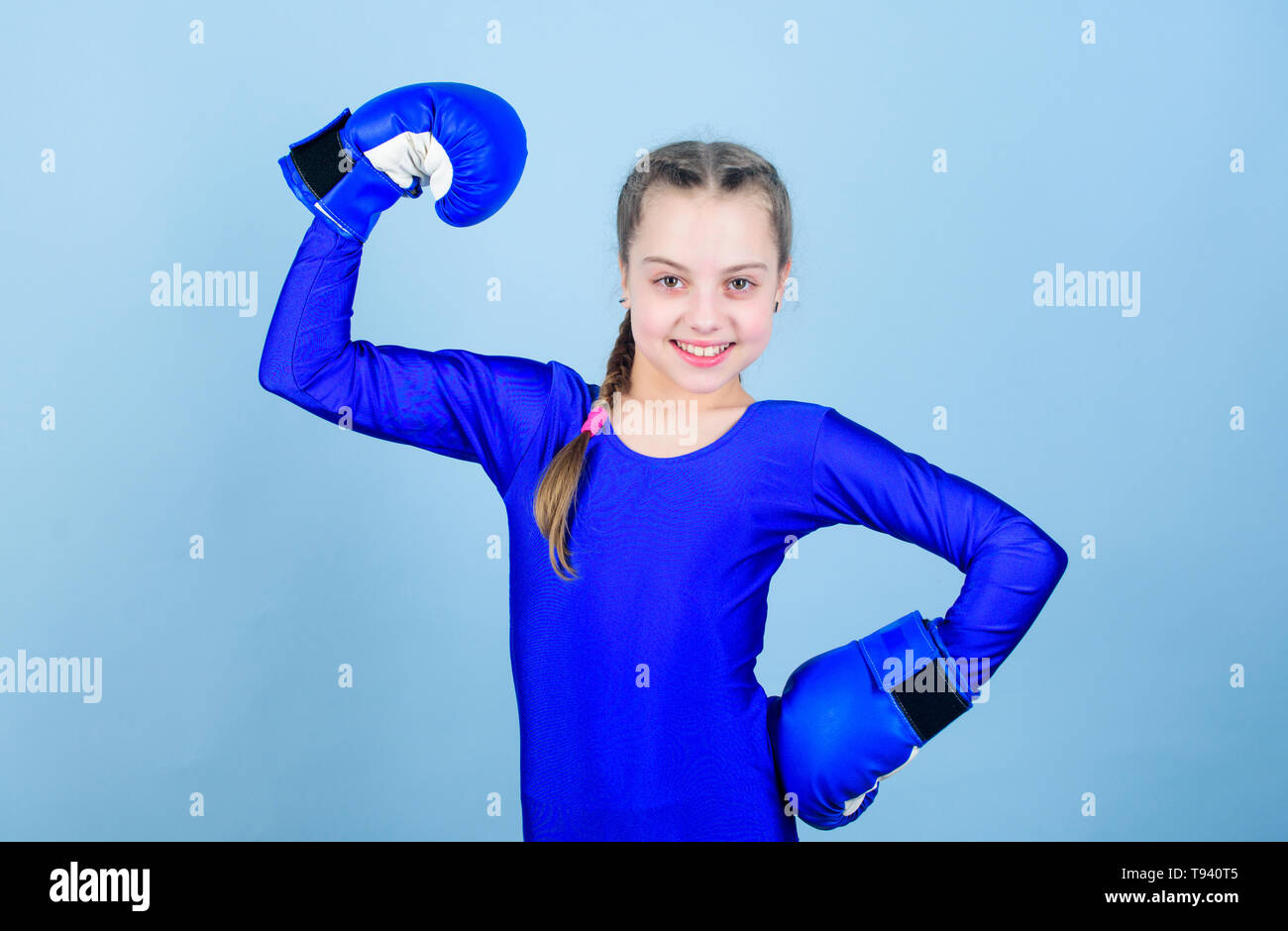 Training to be the best. punching knockout. Childhood activity. Fitness diet. energy health. workout of small girl boxer. Sport success. sportswear fashion. Happy child sportsman in boxing gloves. - Stock Image