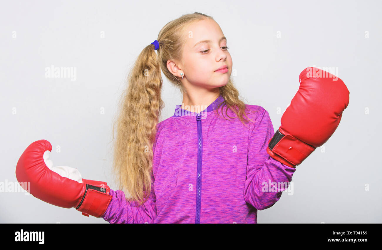 Boxer child workout, healthy fitness. knockout and energy. Sport success. Sport and sportswear fashion. little girl in boxing gloves punching. training with coach. Fight. I am ready to fight. - Stock Image