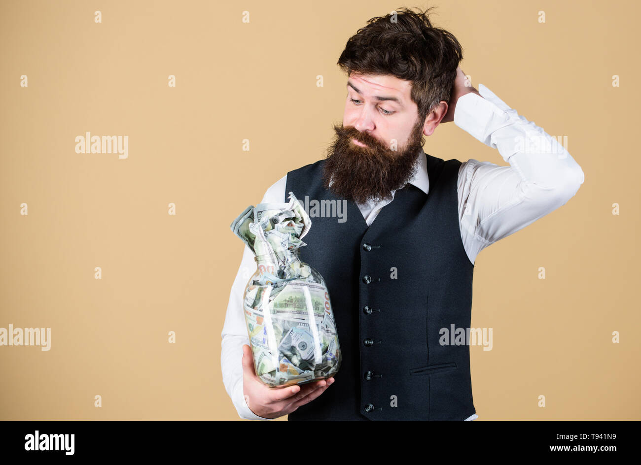What is a good way of investing money. Bearded man thinking of investing money into business. Businessman calculating his future cash flow from investing activities. Investing in future, copy space. - Stock Image