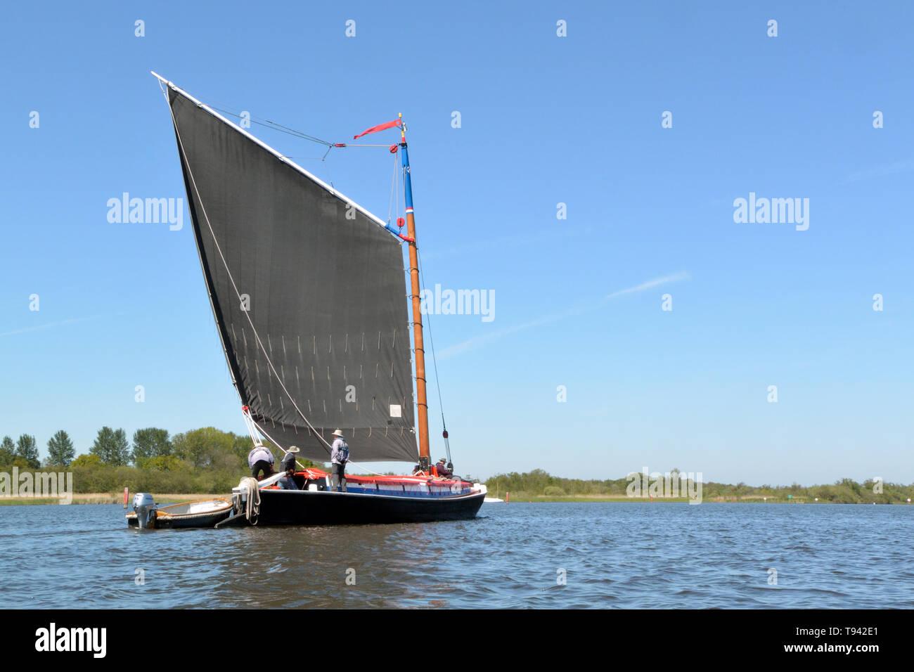 Historic trading wherry Albion under sail on Barton Broad, Broads National Park, Norfolk, UK Stock Photo