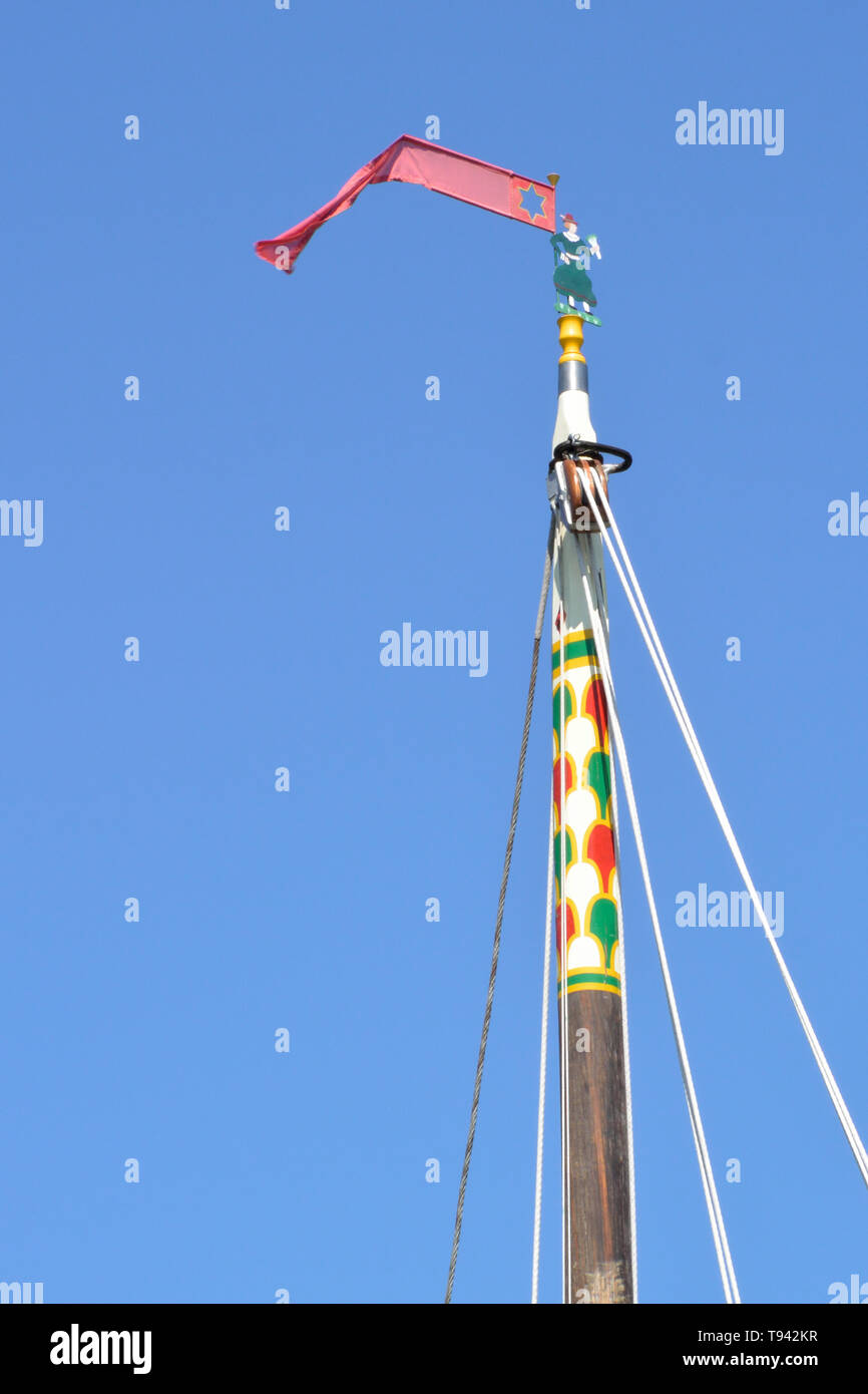 Jenny Morgan on the mast of historic pleasure wherry Hathor moored at How Hill, River Ant, Broads National Park, Norfolk, UK Stock Photo