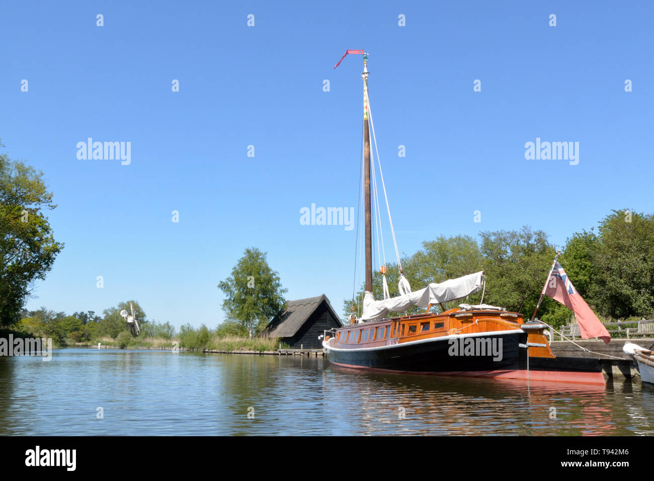 Historic pleasure wherry Hathor moored at How Hill, River Ant, Broads National Park, Norfolk, UK Stock Photo