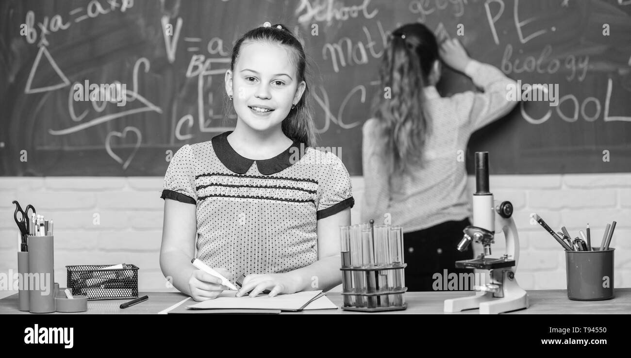 Make studying chemistry interesting educational experiment concept girls classmates study chemistry microscope and