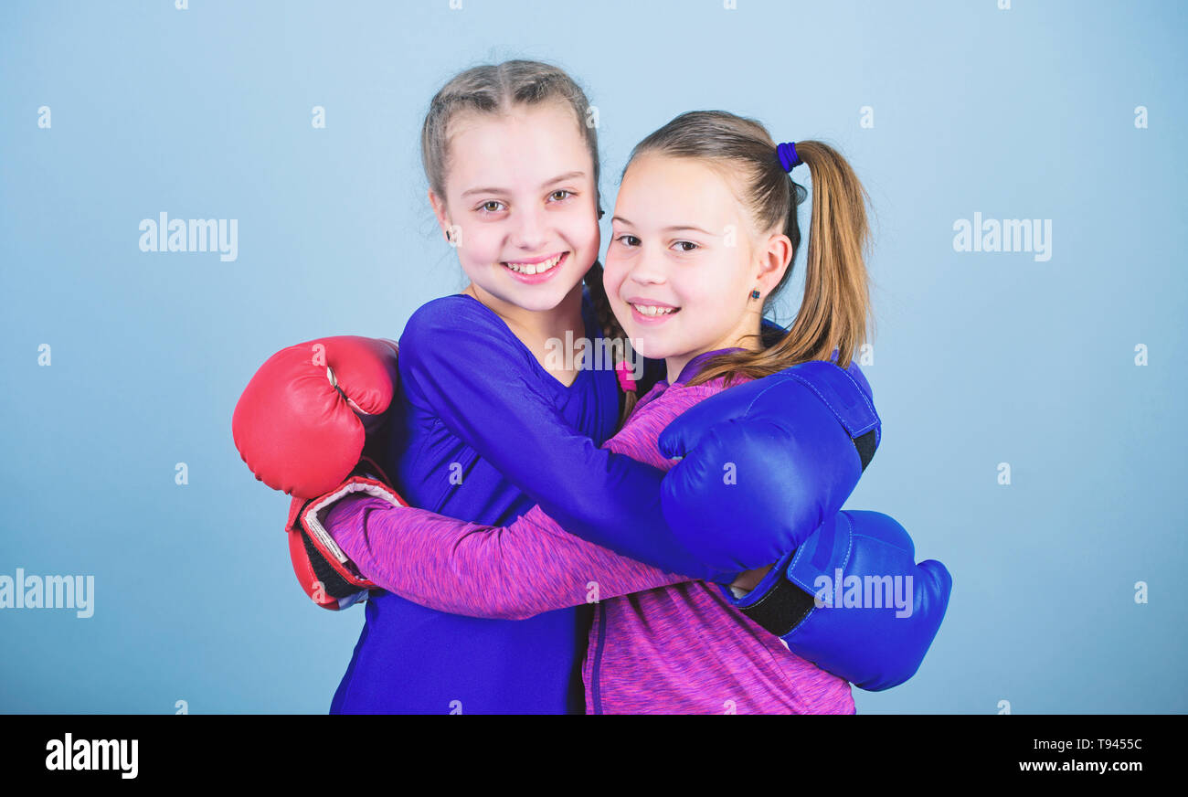 Sport success. Friendship. workout of small girls boxer in sportswear. punching knockout. Fitness diet. energy health. Happy children sportsman in boxing gloves. Training their boxing skills. - Stock Image