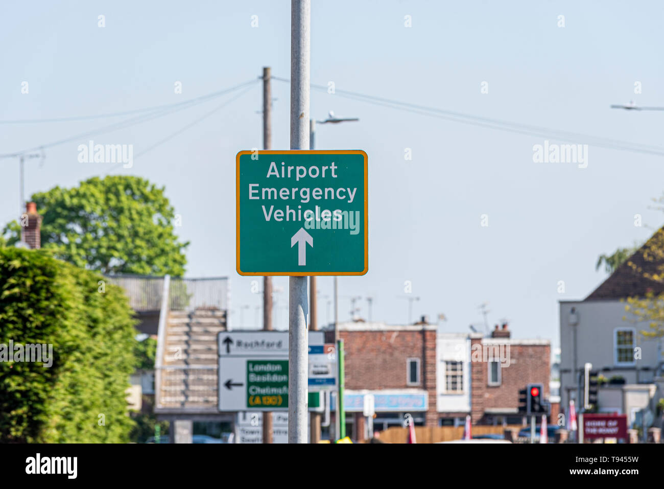 Airport emergency vehicles sign for London Southend Airport, Essex, UK approaching The Bell junction of A127 Prince Avenue, Westcliff on Sea. Arrow - Stock Image