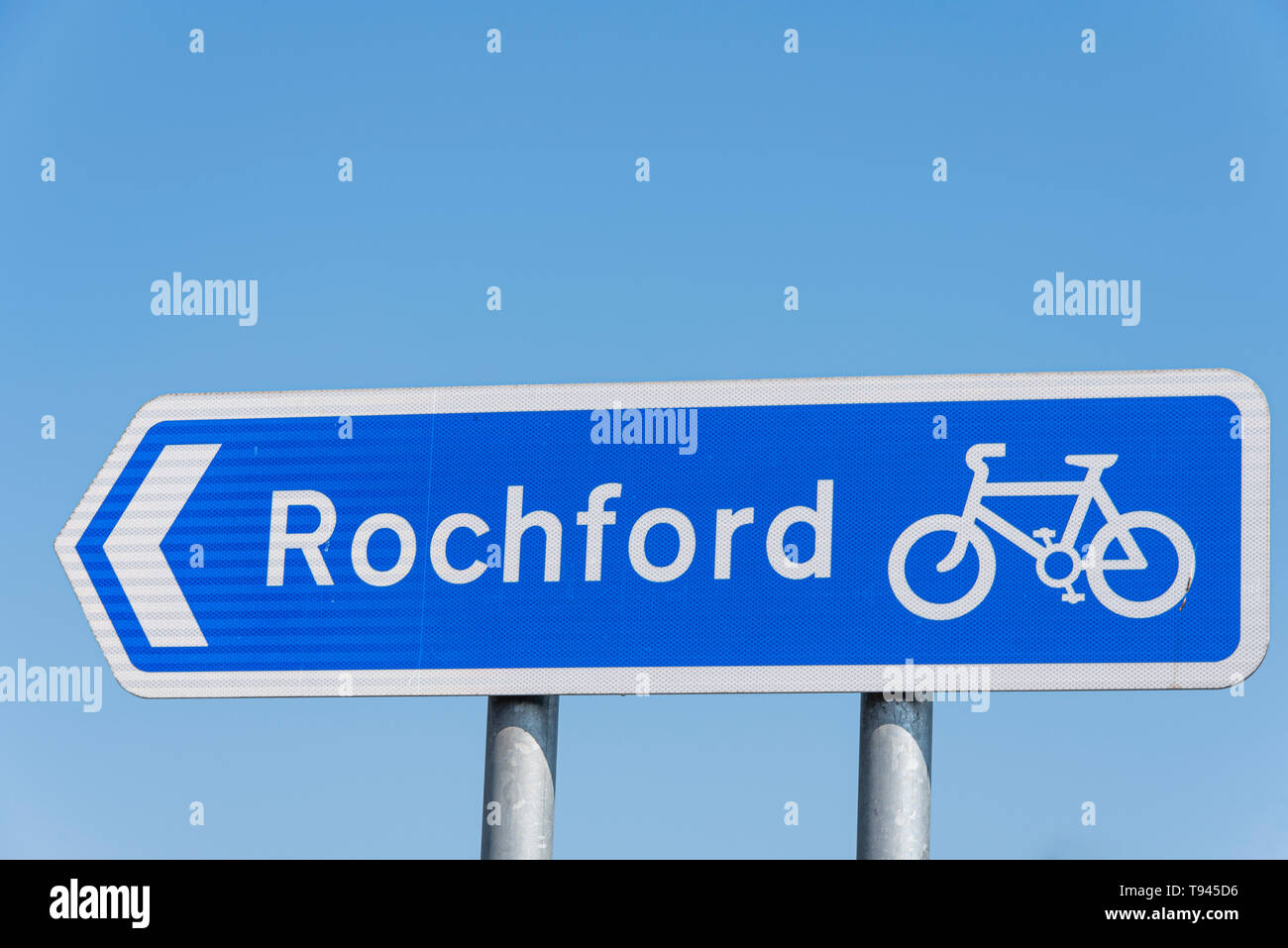 Cycle route blue sign to Rochford, Essex, UK. Blue sign, white arrows. Highway Code recommended route for pedal cycles. Space for copy - Stock Image
