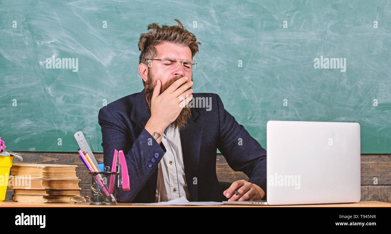 Educators more stressed at work than average people. High level fatigue. Exhausting work in school causes fatigue. Educator bearded man yawning face tired at work. Life of teacher full of stress. - Stock Image