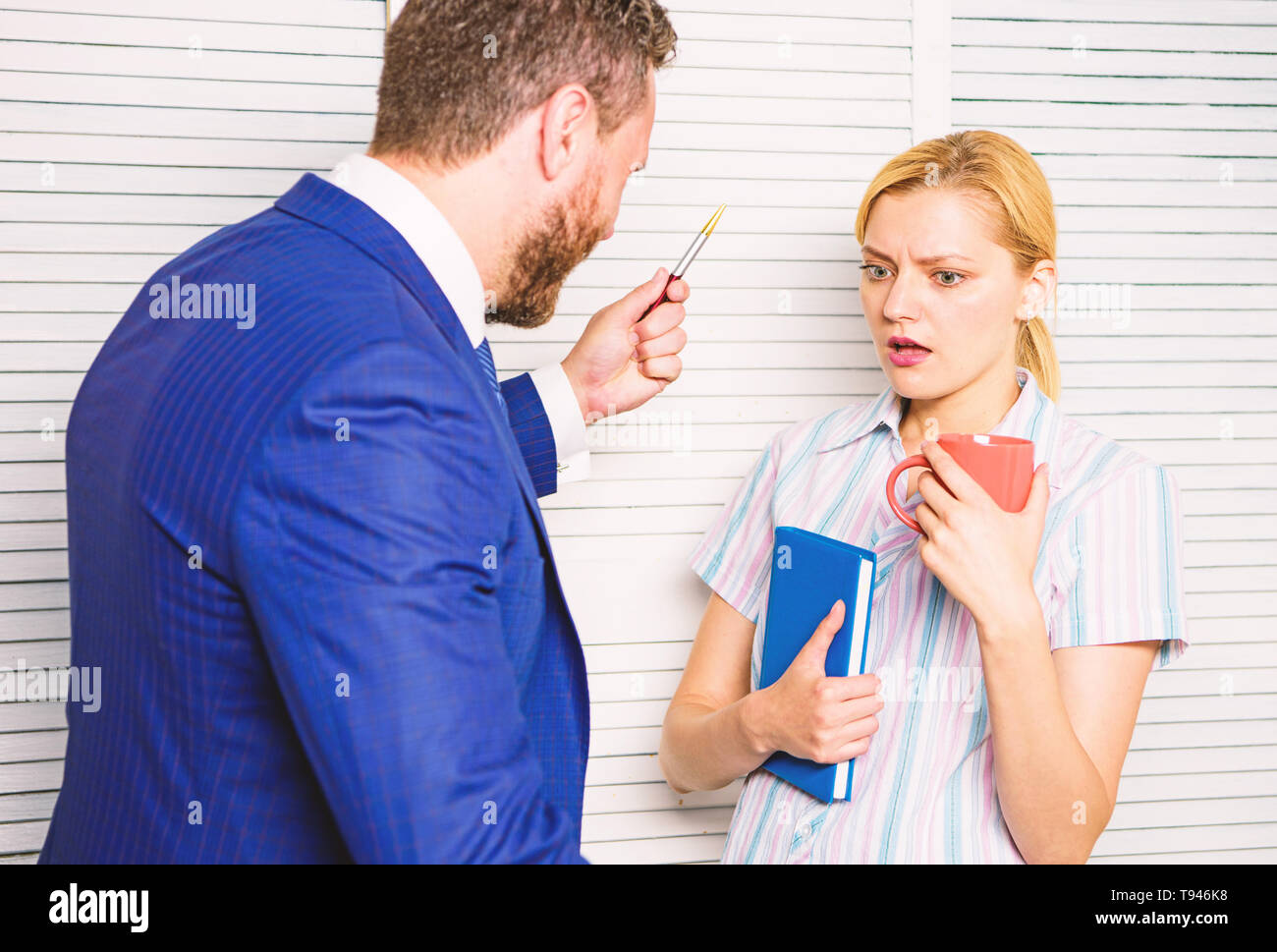 Prejudice and personal attitude to employee. Tense conversation or quarrel between colleagues. Boss discriminate female worker. Discrimination and personal attitude problem. Discrimination concept. - Stock Image